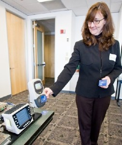 Photo of Kathleen McMurray (ORCA Technical Manager) with Fare Transaction Processor (FTP) Demo.