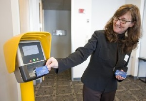 Photo of Kathleen McMurray (ORCA Technical Manager) with Stand  Alone Fare Transaction Processor (SAFTP) Demo.