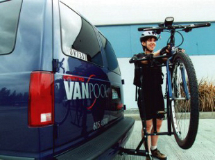 Bicyclist loading bike on a van rack