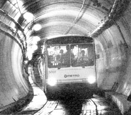 Photo of bus traveling through tunnel, 1990.