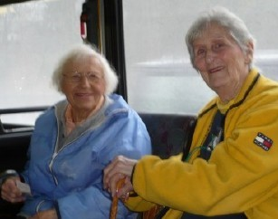 Photo of two senior citizens on a bus