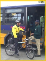 Photo: Transit officer discusses security issues with a Transit Operator