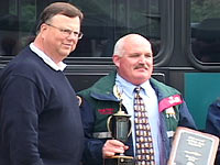 Photo: Metro Transit General Manager Rick Walsh congratulates 2003 Metrodeo winner Michael Grady.