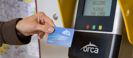 An ORCA card being tapped on a card reader