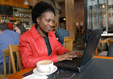 A woman working from a coffee shop.